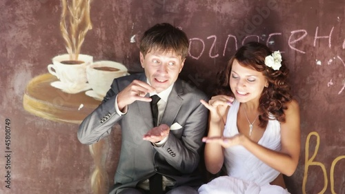 Young family drinking coffee