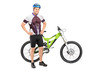 Full length portrait of a bicyclist posing next on a mountain bi