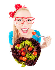 Cheerful funny girl eating salad