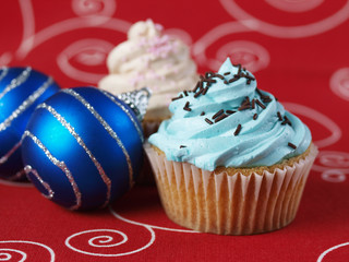 Two cupcakes with christmas balls 2