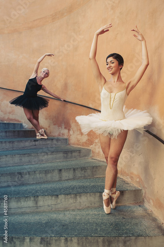Young beautiful ballerinas dancing on the stairs.
