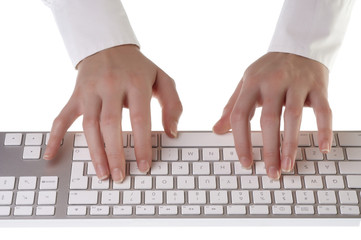 Woman typing on keyboard on white background
