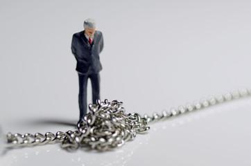 鎖とビジネスマン