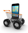 Modern mobile phone in a shopping trolley.