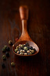 Peppercorns on a wooden spoon