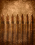 Military background, bullets on scratched brown texture
