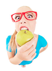 Funny  girl biting an apple isolated on white, fish eye lens