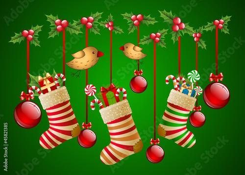 Hanging christmas socks with present and balls.
