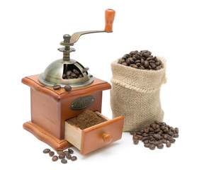 coffee grinder and coffee beans on a white background