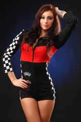 girl in a racing suit posing in studio