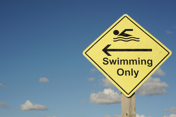 Swimming only sign