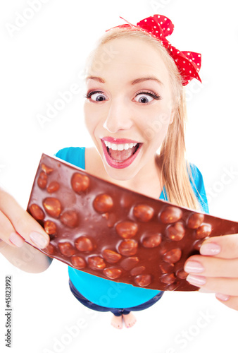 Funny excited girl with a chocolate isolated on white