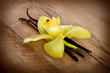 Vanilla Pods And Flower on a Wooden Background