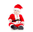 funny little kid in Santa claus clothes