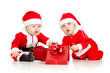 babies boys in Santa Claus clothes with gift box
