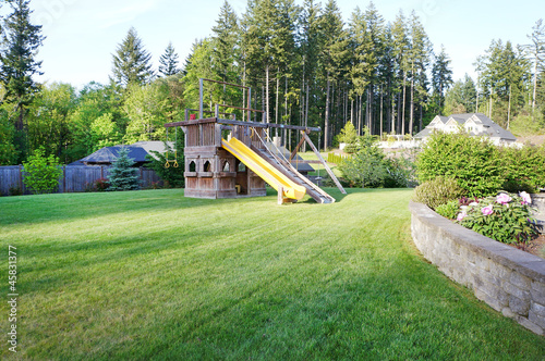 Large wood play ground for kids at private home back yard.