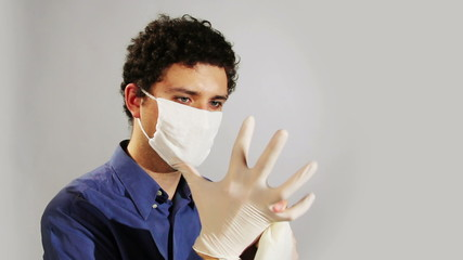 young doctor wearing medical gloves
