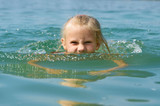 Little girl swimming in lake