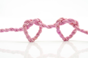 pink rope heart shaped symbol
