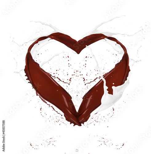 Heart symbol made of chocolate and milk splashes