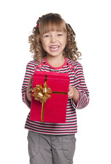 Little girl with gift box