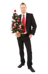 Fescher Weihnachtsmann mit Tannenbaum