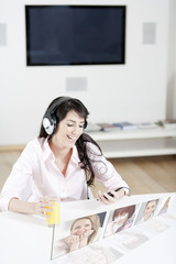 Young woman listening to music & chatting with friends