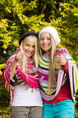 Two Girls Thumb Up