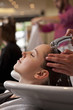A female client having her hair washed in a hairdressing salon
