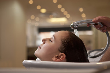 A woman having her hair washed in a hairdressers close up