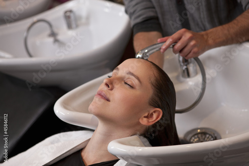A woman having her hair washed in a hairdressers, close up