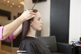 A female client having her hair cut in a hairdressing salon