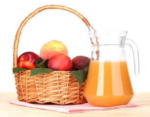 Ripe peaches in basket and juice