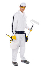 painter in white overalls holding paint brush bucket on a white
