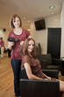 A female hairdresser blow drying her female clients hair