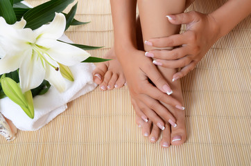 Woman hand and feet with manicure