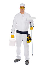 worker in white overalls holding paint brush bucket