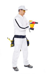 worker in white overalls drilling a hole on a white background