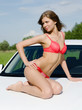 Sexual girl in bikini with car