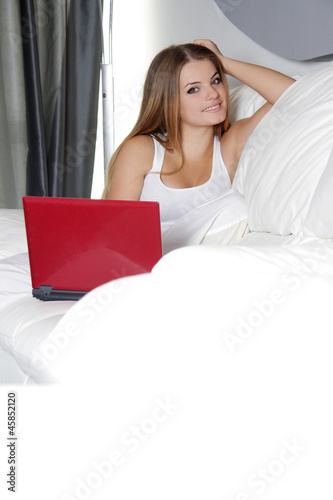 young happy woman with laptop at home