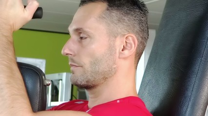 attractive man at chest exercises
