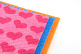 Orange, pink and blue napkins over white