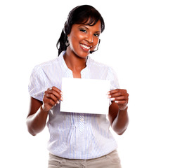 Adult female wearing headphones holding white card