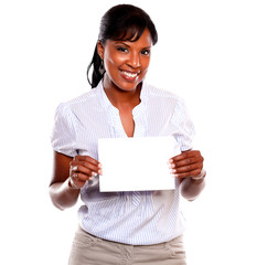 Charming young woman holding a white card