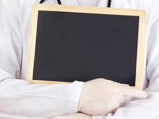 Doctor shows information on blackboard