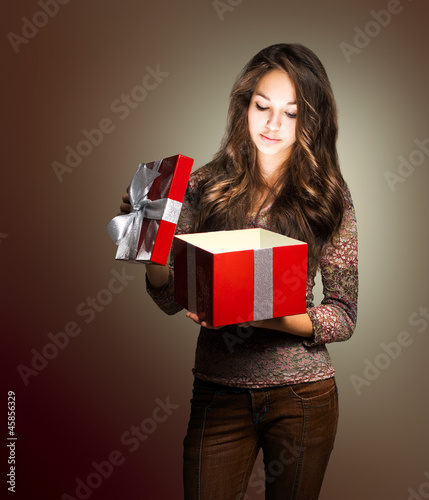 Young beauty with red gift box.