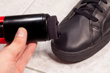 Closeup of cleaning black shoes with black paste
