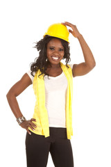 woman yellow hard hat hand