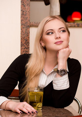 Portrait of beautiful young woman drinking tea in restaurant