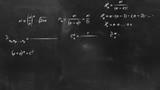math physics formulas on chalkboard flying camera